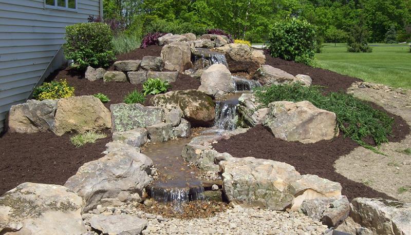 20 Backyards With Stunning Waterfalls-14