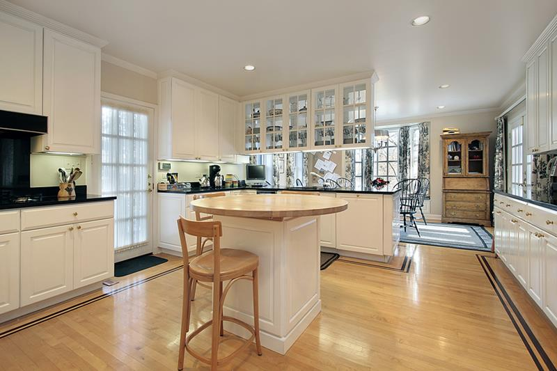 Kitchen with butcher block island in luxury home