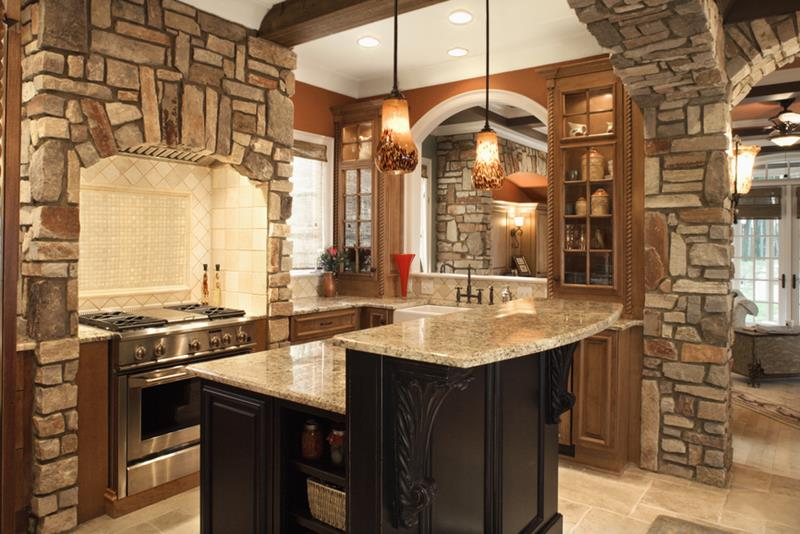 Upscale kitchen interior with stone accents and wood beam ceiling. Horizontal shot.