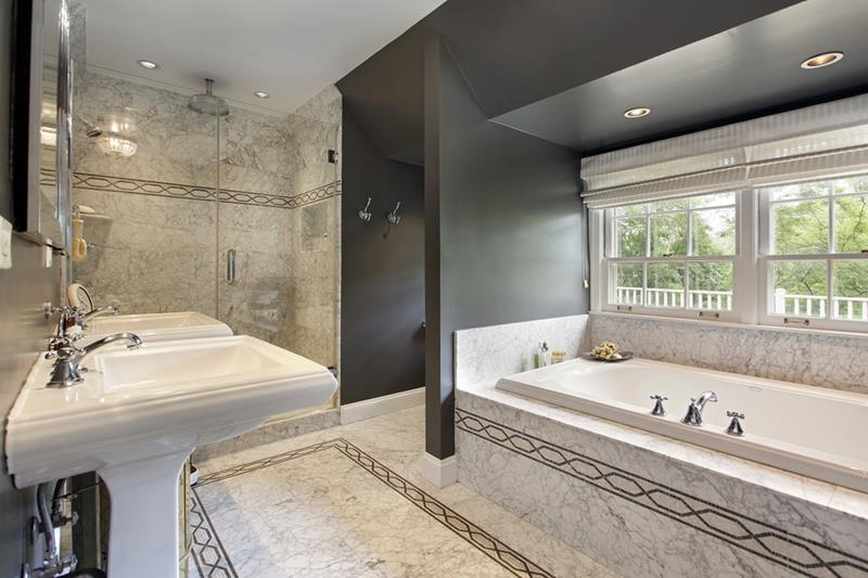 Modern master bath with marble flooring and glass shower