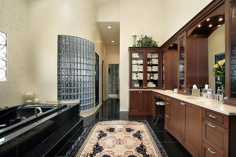 Master bath in luxury home with black tub