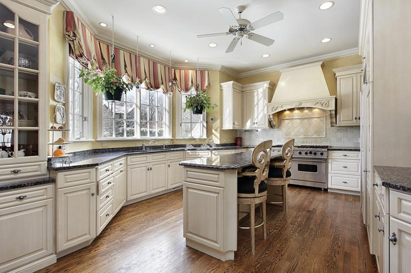 Kitchen in luxury home with marble island