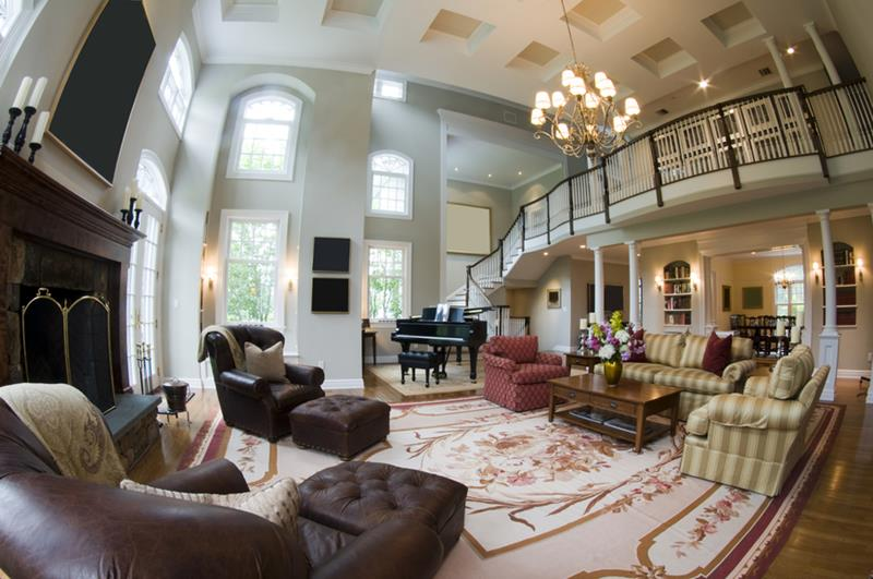 fish eye wide angle view of living room with fireplace and grand piano and french doors in luxury estate mansion home