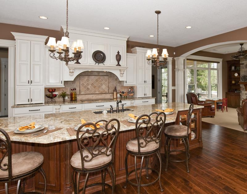Luxury kitchen with custom cabinetry and granite countertops.