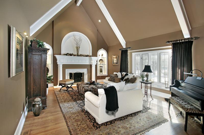 Living room in luxury home with fireplace and white beams